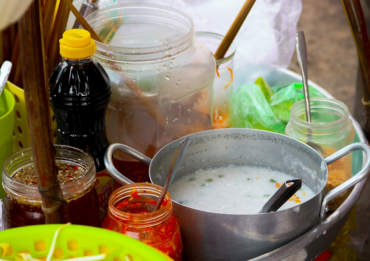 The soul of the dish lies in a pot of coconut cream cooked on a small charcoal pot and the vendor adds a little salt, sugar, tapioca flour (or cornstarch) into the pot to ensure a sweet, and fatty taste. Banh tam bi dish would be incompete without being drenched with coconut cream.